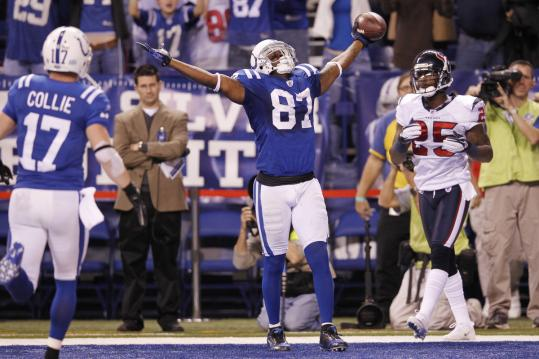 The Colts' Reggie Wayne celebrates after catching a 1-yard TD pass with 19 seconds to play.