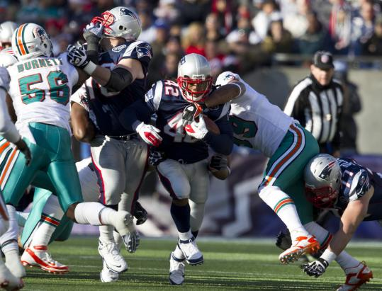 Logan Mankins (left) opened a hole for BenJarvus Green-Ellis before exiting with a knee injury.