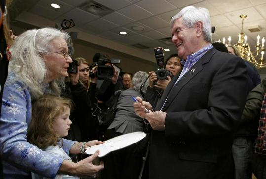 Newt Gingrich flashed his upbeat side during a campaign stop yesterday at the Dubuque Golf and
