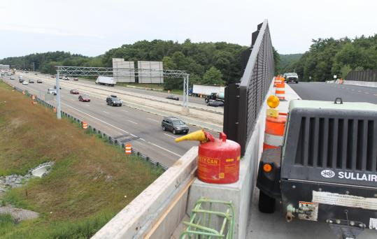 The bridge over Route 128/Interstate 93 near Houghton's Pond in Milton offered a view of the widening project in July 2010.
