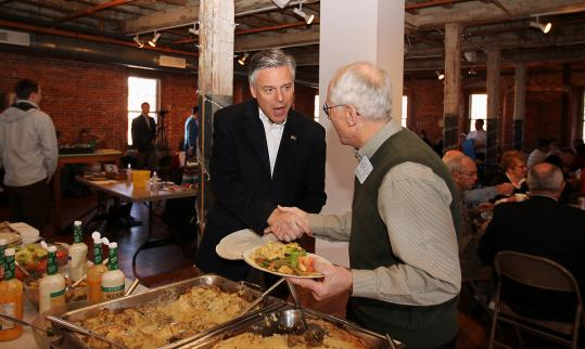 Jon Huntsman greeted James Eakin at the Rotary Club in Laconia, N.H. He has focused more on the state than on Iowa.