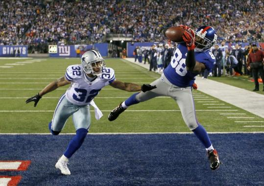 Hakeem Nicks finished off the Giants' victory with a 4-yard touchdown catch with 3:41 to play.