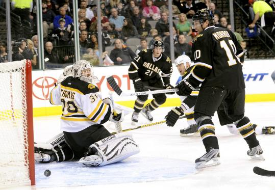 Tim Thomas watches as a shot by the Stars&#8217; Loui Eriksson gets past him for a first-period goal Saturday night.