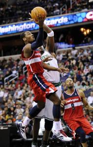 Wizards guard John Wall goes to the basket against Jermaine O'Neal during the second half of the Celtics' 94-86 win last night.