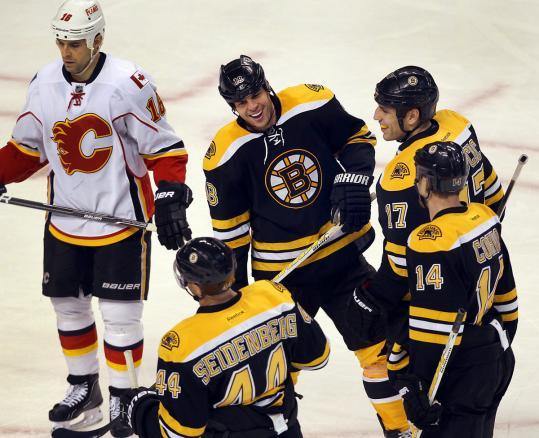 Nathan Horton (center) is a happy man after his second goal of the second period put the Bruins up, 7-0.