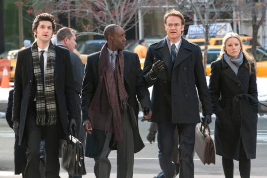 "From left: Ben Schwartz, Don Cheadle, Josh Lawson, and Kristen Bell in ""House of Lies,'' a new drama on Showtime."
