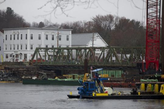 Scenes from last month show crews sinking footings into the Merrimack River to support a replacement for the Bates Bridge, which carries Route 97 between Groveland and Haverhill.
