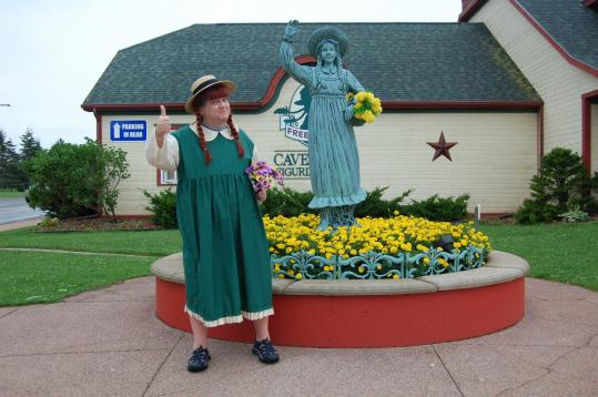 Darren Garnick dressed as Anne of Green Gables to visit the character's statue on Prince Edward Island.