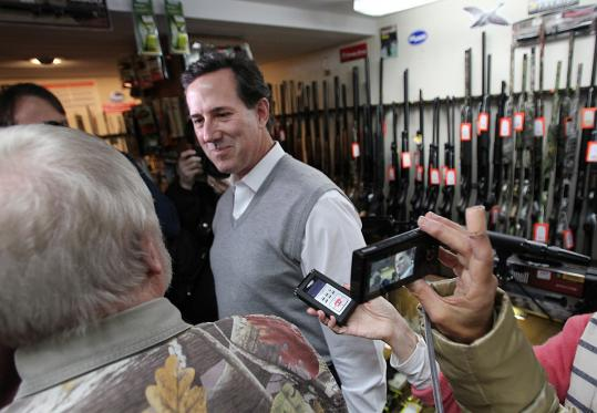 Rick Santorum, at a sports shop in Jaffrey, N.H., yesterday, is the dark horse.