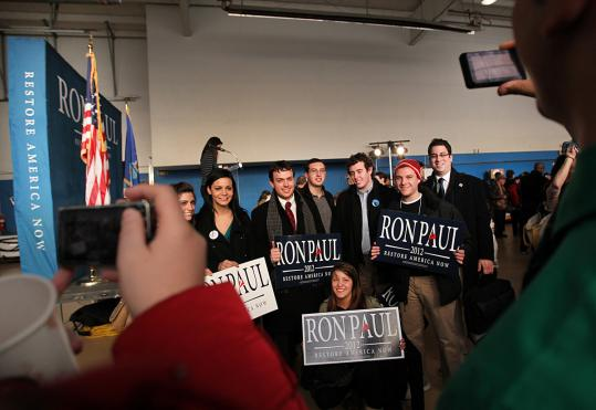 A group of young supporters campaigned with Republican Ron Paul yesterday at an airport hangar in Nashua.