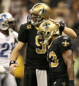 Darren Sproles gets a pat on the helmet from Drew Brees after his fourth-quarter touchdown.