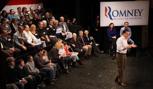 Mitt Romney campaigned in Rochester, N.H. Senator Kelly Ayotte and Tim Pawlenty, former governor of Minnesota, sat behind him.