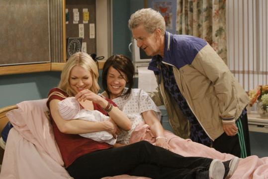 "From left: Laura Prepon, Chelsea Handler, and Lenny Clarke in the new NBC sitcom ""Are You There, Chelsea?''"