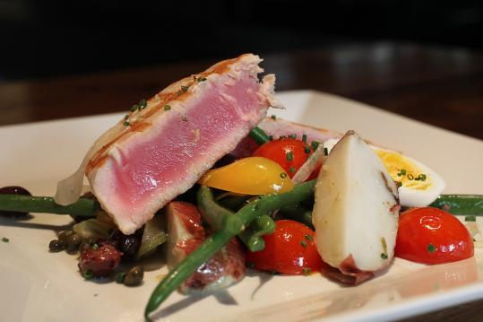 Above: Tuna Nicoise includes haricots verts, tomatoes, potatoes, and hard-boiled egg. Below: Spicy Buffaloed rock shrimp is complemented by blue cheese fondue. Near MIT in Cambridge, the often-busy restaurant attracts a techie crowd.