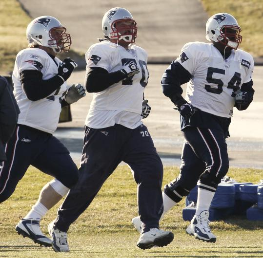 "Offensive lineman Logan Mankins, seen here running drills in Tuesday's practice, is still bothered by his sprained knee ligament and considers himself ""day-to-day.''"