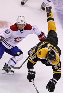 The Bruins' Benoit Pouliot was given a ride courtesy of Montreal's Raphael Diaz.