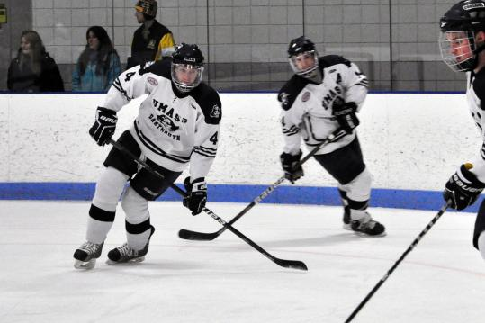 MA H.S.: Ginand Brothers Of Milford Star On The Ice, 4,000 Miles Apart