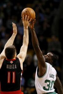 Celtics forward Brandon Bass rises to the occasion to block Raptors' forward Linas Kleiza's shot in the second quarter.