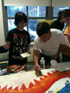 Eighth-grader Chase Peters works with visiting artist Bruce Davidson, who was helping Bromfield School students create a triptych celebrating the Chinese calendar's Year of the Dragon.