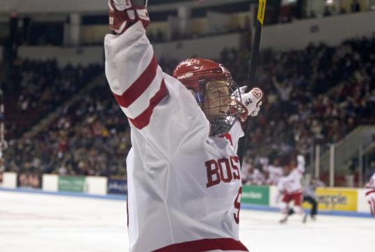 Alex Chiasson celebrates his first-period goal, one of four by second-ranked Boston University in its win over Providence.