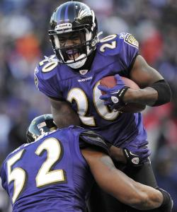 Ray Lewis (52), always one of Ed Reed's biggest supporters, celebrates the safety's winning pick against the Texans.