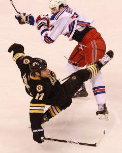 One of many hard hits at TD Garden yesterday: The Rangers' Brian Boyle rattles Milan Lucic.