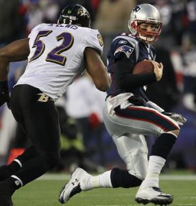 Patriots quarterback Tom Brady tries to avoid linebacker Ray Lewis, who tied for the Ravens' lead in tackles yesterday (12).