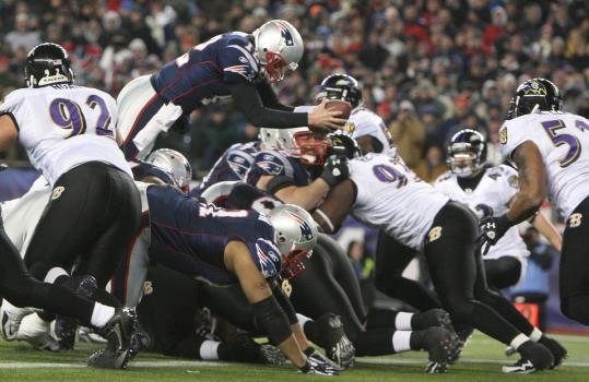 Patriots quarterback Tom Brady leaps into the end zone from a yard out with 11:29 left in the fourth quarter, putting his team ahead of the Ravens, 23-20 . . .