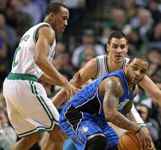 Avery Bradley (left) was all over Orlando's Jameer Nelson Monday, and here he gets help on defense from Sasha Pavlovic.