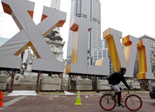 Giant-sized Roman numerals herald the impending arrival of the Giants - and the Patriots - in Indianapolis.
