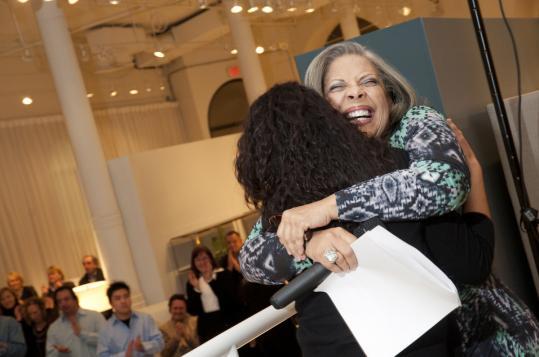 Singer Patti Austin hugs Santana Roberts at a recent mentoring event.