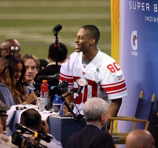 The Giants' Victor Cruz, one of two UMass players at the Super Bowl, handles media chores.