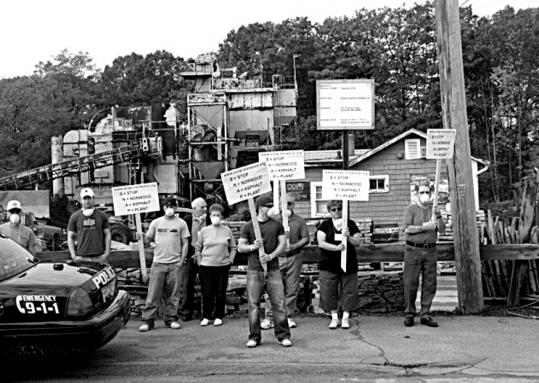 Members of Stop Norwood Asphalt Plant held a protest in front of the Pleasant Street operation in November 2007.