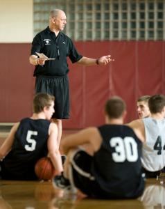 Groton-Dunstable Regional High basketball coach Keith Woods delivers instructions during practice Wednesday, after a two-game losing streak provided several areas for improvement.