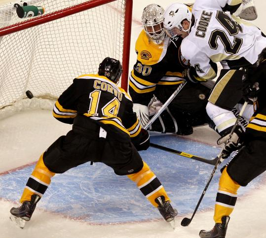 Matt Cooke barges between goalie Tim Thomas and Joe Corvo to score what ended up the winning goal for Pittsburgh.