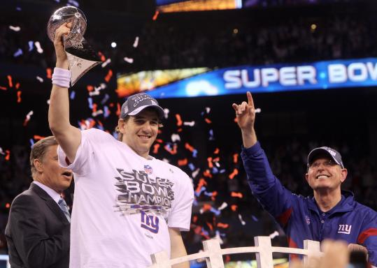 Eli Manning now has the hardware to prove he's earned a spot in the elite quarterback club.