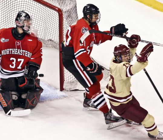 Johnny Gaudreau (right) gave NU goalie Chris Rawlings the slip on this first-period goal.