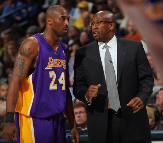 The Lakers still lean on an old favorite, Kobe Bryant (left), but with a new coach, Mike Brown.