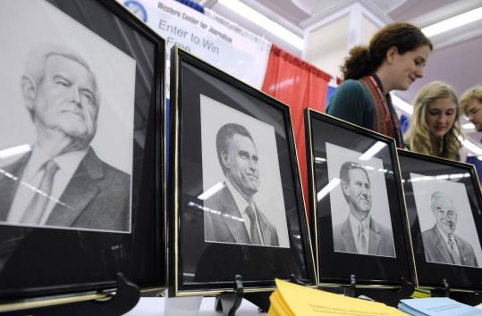 Drawings of Republican presidential candidates Newt Gingrich, Mitt Romney, Rick Santorum, and Ron Paul were on display at a booth at the Conservative Political Action Conference in Washington yesterday.