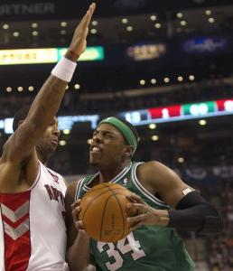 The Celtics' Paul Pierce (12 points) put his shoulder into it on this drive against the Raptors' James Johnson.