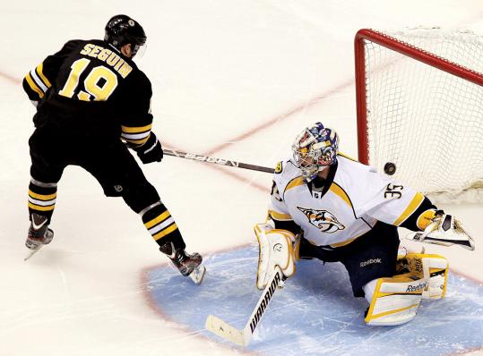 Tyler Seguin makes a nifty move to beat Nashville goalie Pekka Rinne with a backhander on Boston&#8217;s second shootout attempt.