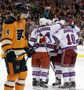 The celebrating started early for the Rangers, who gather to honor Martin Gaborik (right) for his go-ahead goal in the first period.