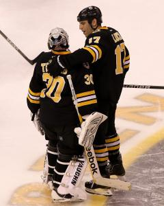 Tim Thomas and Milan Lucic celebrate Saturday's tough shootout win vs. Nashville.