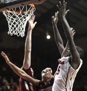 Virginia Tech's Dorian Finney-Smith scores the winning basket despite the efforts of several Boston College players.