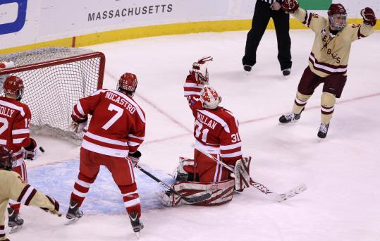 BC's Pat Mullane (upper right) celebrates a goal by teammate Chris Kreider (not pictured) that put the Eagles ahead, 2-1, in the Beanpot championship game vs. BU.