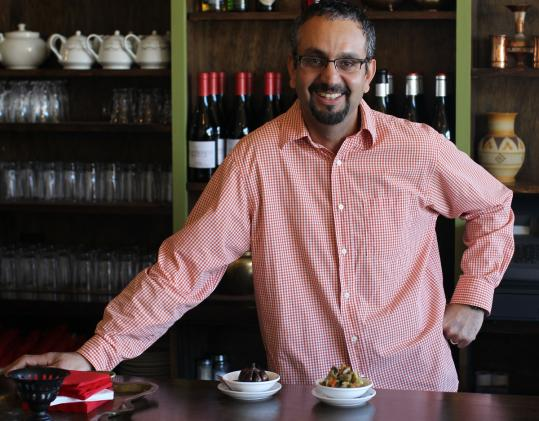 Mehran Khosrowdad (above) co-owns Sabzi Persian Chelow Kabab in Arlington. Among the dishes are (below, from left) kabab-e jujeh, a Cornish hen and rice dish, and kashk-e bademjan, a dark, roasted and sauteed eggplant spread.
