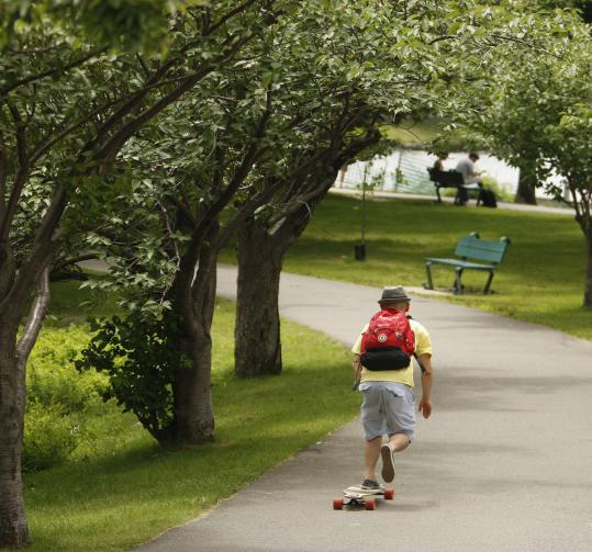 A man rides his skateboard at the Charles River Esplanade last summer.