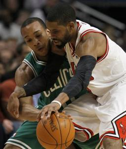 Celtics guard Avery Bradley attempts to steal the ball from the Bulls' C.J. Watson.