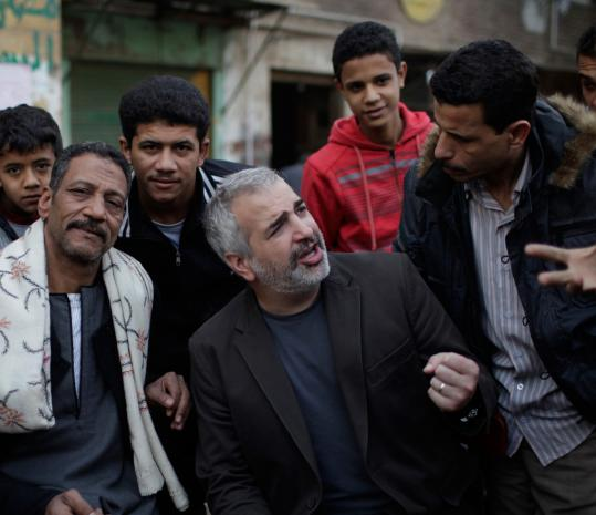 Anthony Shadid, middle, interviews residents of Embaba, a Cairo neighborhood, in February 2011.