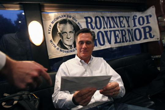 Mitt Romney's father, pictured in an old political poster, was very much on the candidate's mind as he campaigned in his home state of Michigan.